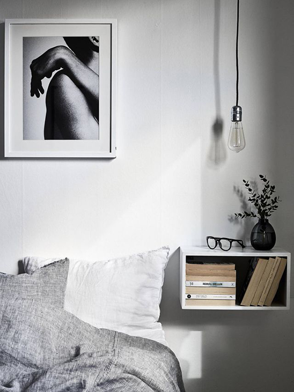 Tassels & Tigers Interior Decor and Design suggests using ceiling pendants and floating shelves to save space in a dual purpose bedroom, nursery or study