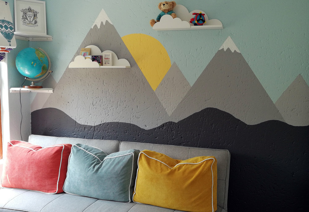 Mountain and sky feature wall painted by Tassels & Tigers Interiors in baby nursery.jpg