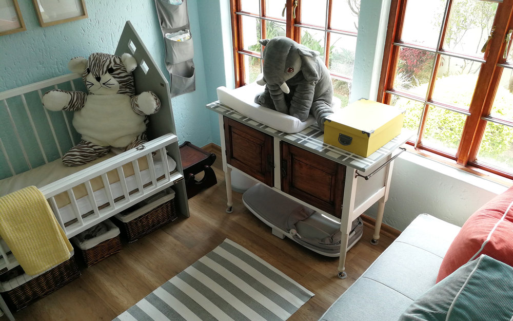 Areal View of a travel themed nursery by Tassels & Tigers Interiors.jpg