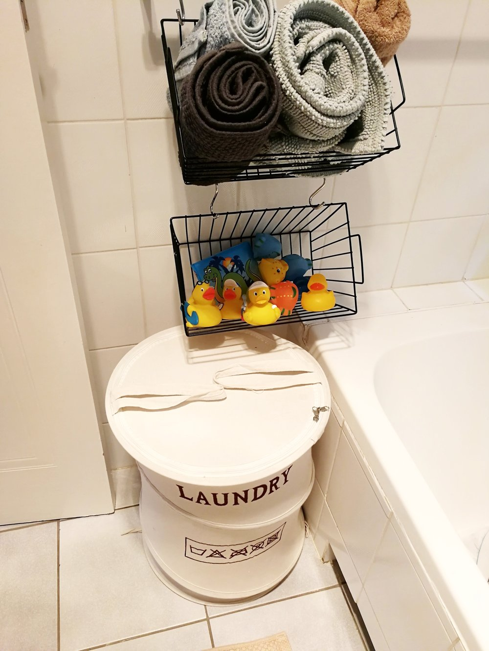 Clever baby and kids bathroom toys storage solution by Tassels & Tigers interiors in Johannesburg