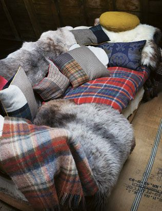 tartan scatters on couch with sheepskin throw.jpg