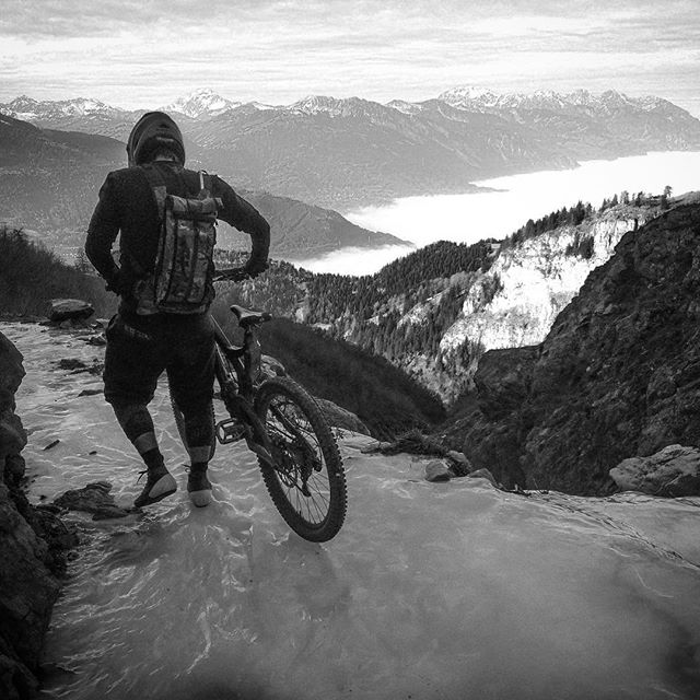 Flash back to just over a year ago: freak icy cold temperatures but no snow in the Alps, unlike right now where it's been dumping for weeks on end. A wild recon mission organised by @chamonixmtb to find a trail into the back of beyond, amidst permafrost forest trails and alpine sun above the clouds. A hike a bike took a group of us over frozen waterfalls, looking down into the Swiss valleys below, from the Dent de Morcles. .
