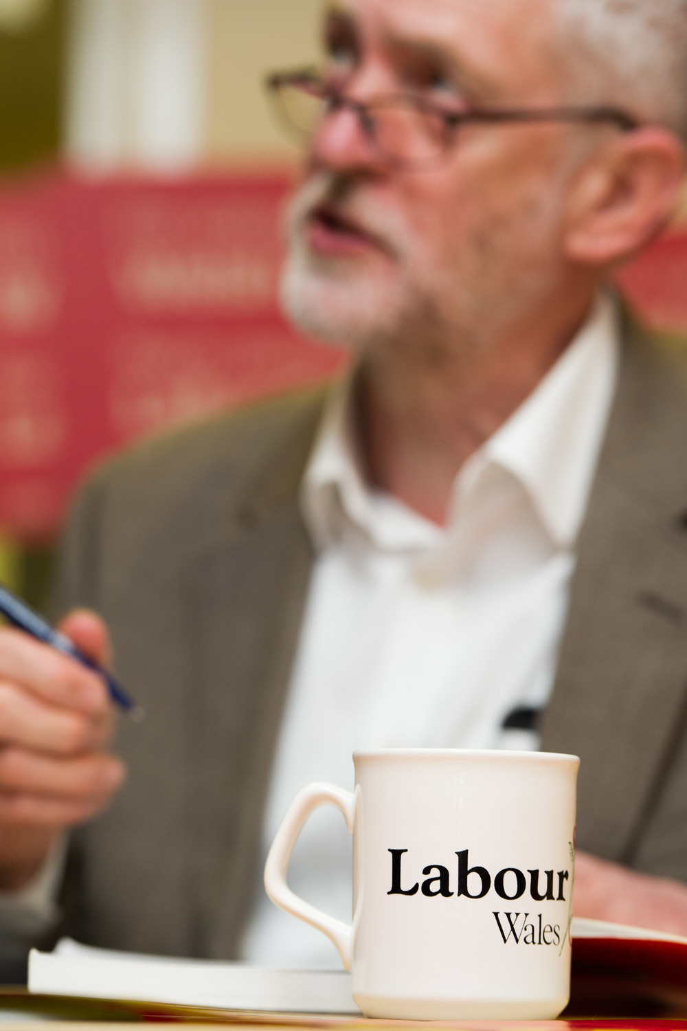 Labour leader Jeremy Corbyn signing a book for a supporter.
