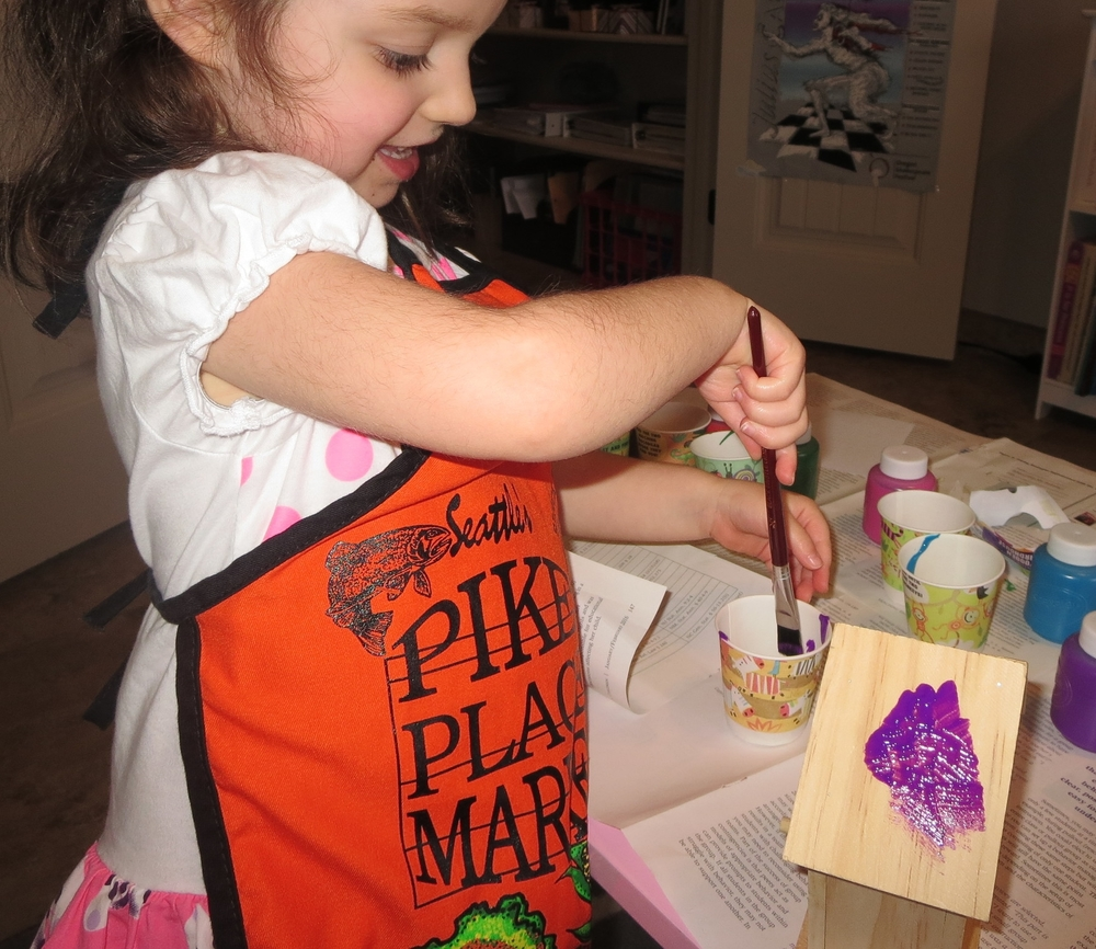 Painting a wooden birdhouse