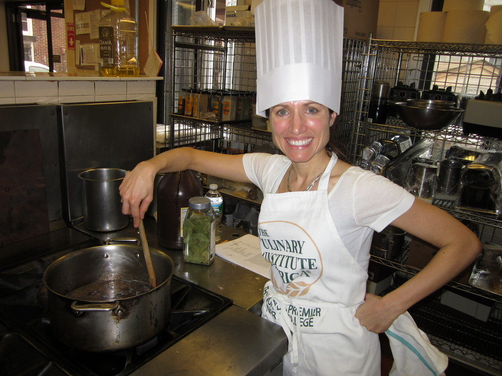 Macy making  onion soup gratinée at the Culinary Institute of America (CIA)