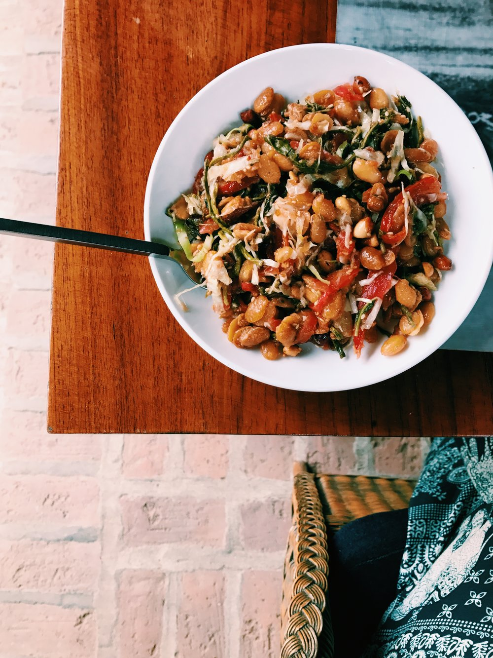 Tea leaf salad.  Fried beans, tomato, chickpea flour, cured tea leaf, cabbage.  Crunchy and delicious.