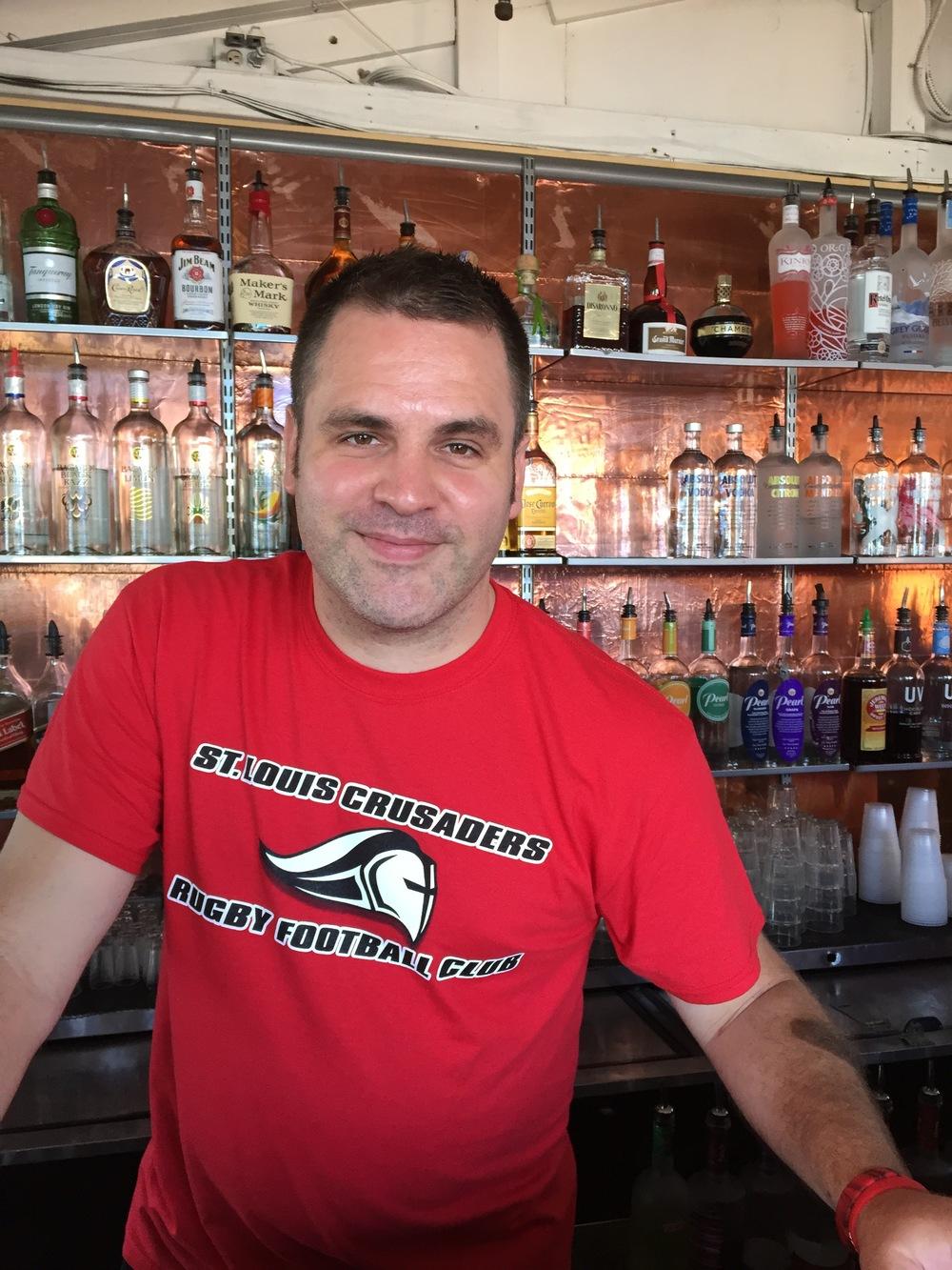 Jaakan working behind the bar