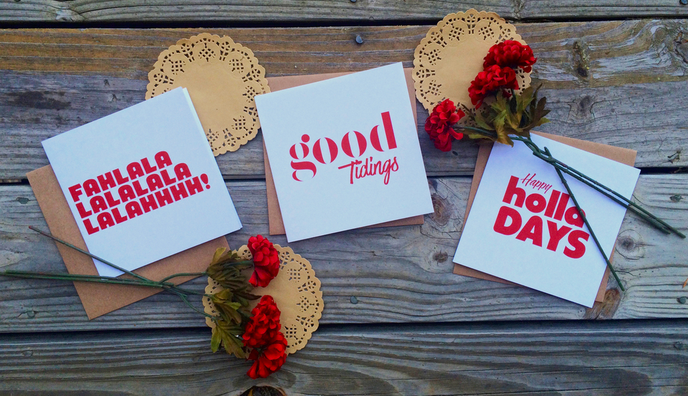 Clean white with just a splash of red, these minimalistic square cards are spunky & festive.