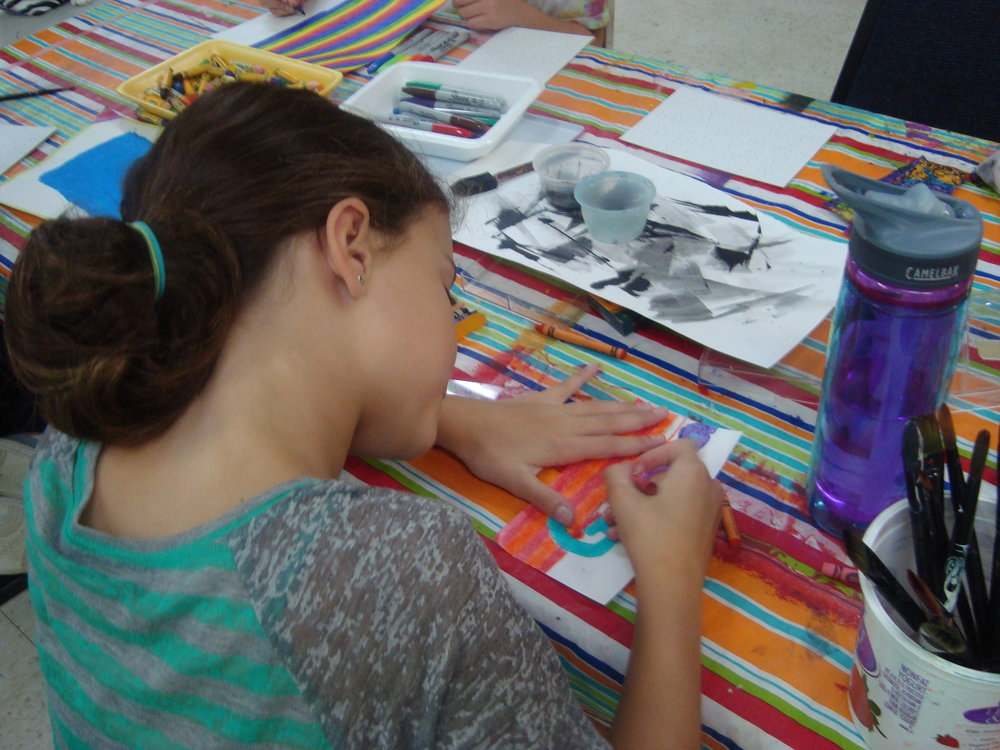 Girl draws in oil pastel.JPG