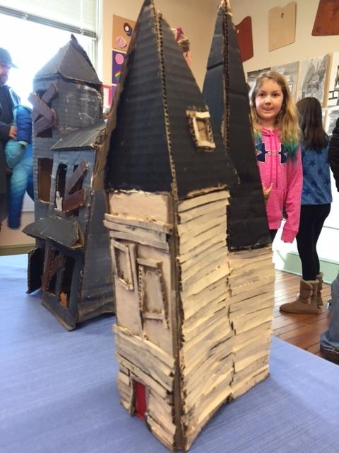 Artwork by kids cardboard house.JPG