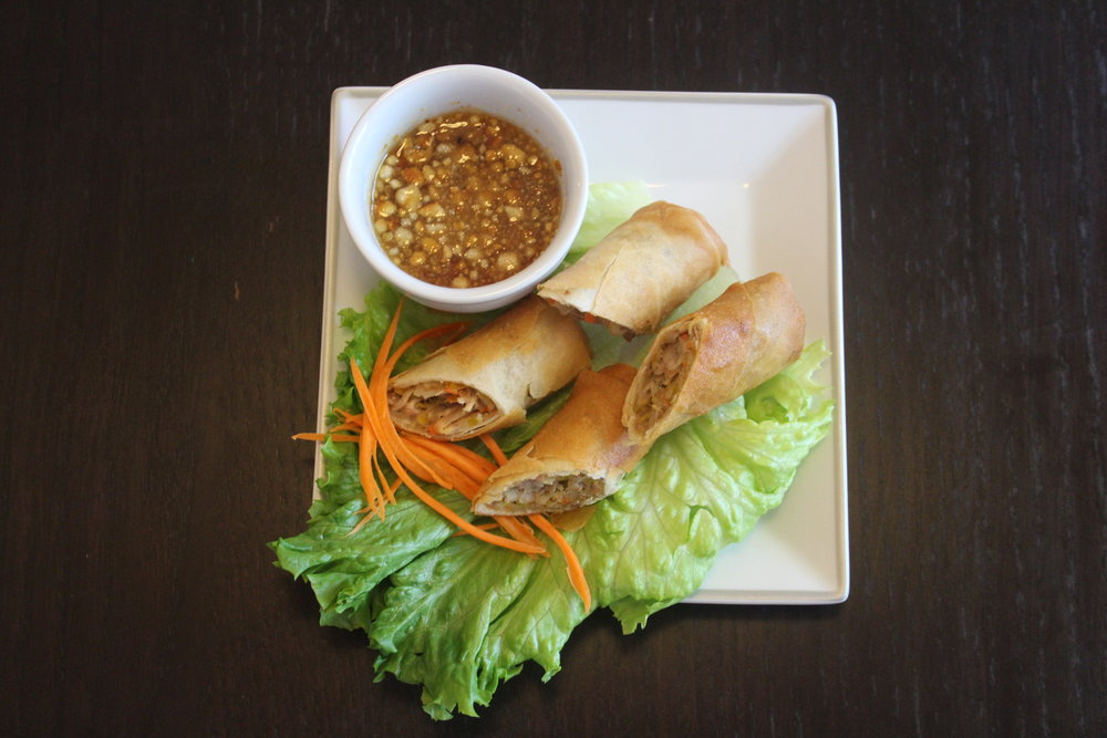 Dish Name: Tod Mun - Spring Rolls with Taro Dining Style: Mix the peanuts and sauce to create the perfect dipping sauce. You can reheat the rolls in the oven (250F for 5-10 minutes) or place them in the microwave for 30 sec.