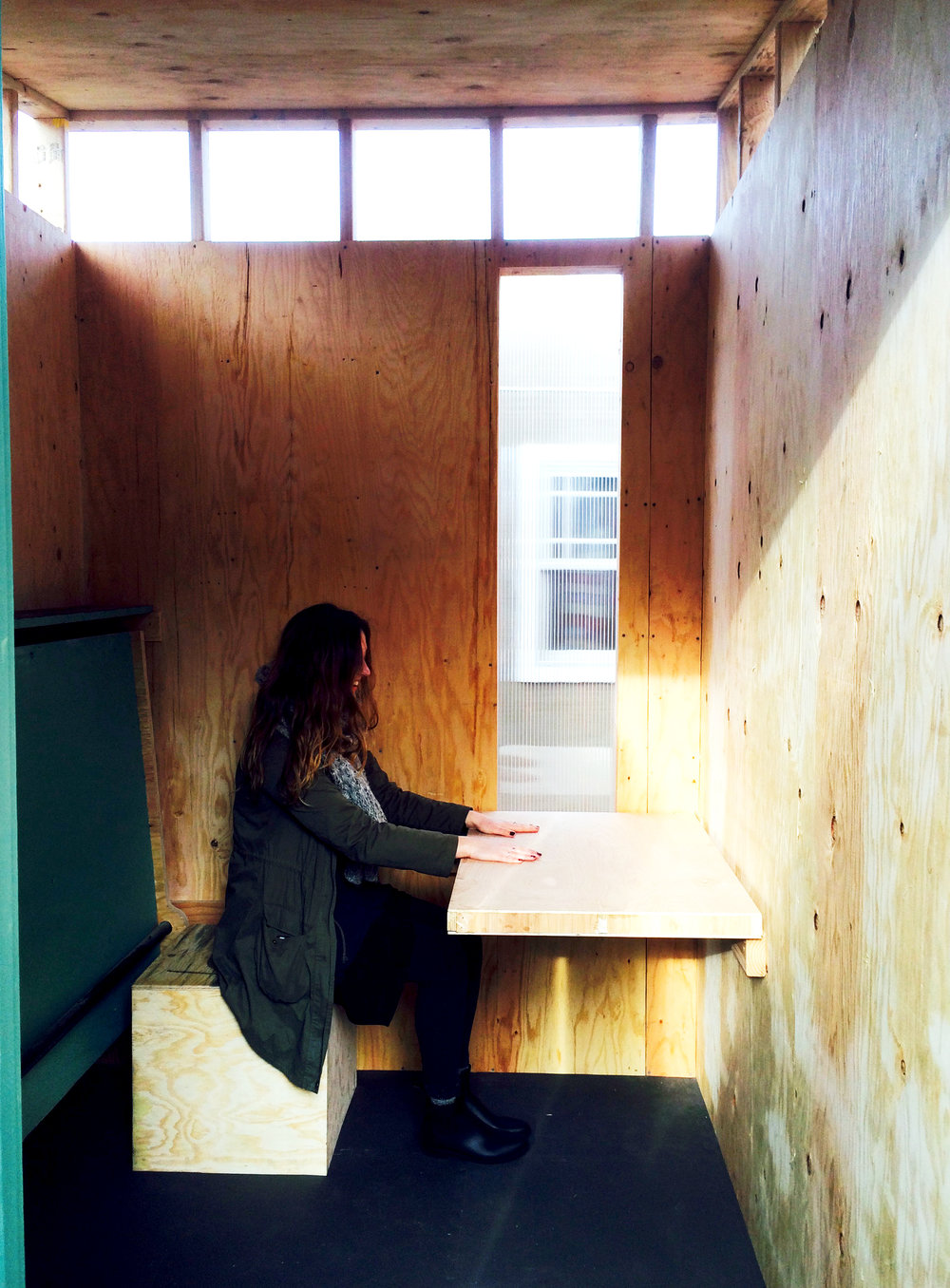 olivia and table on stool.jpg