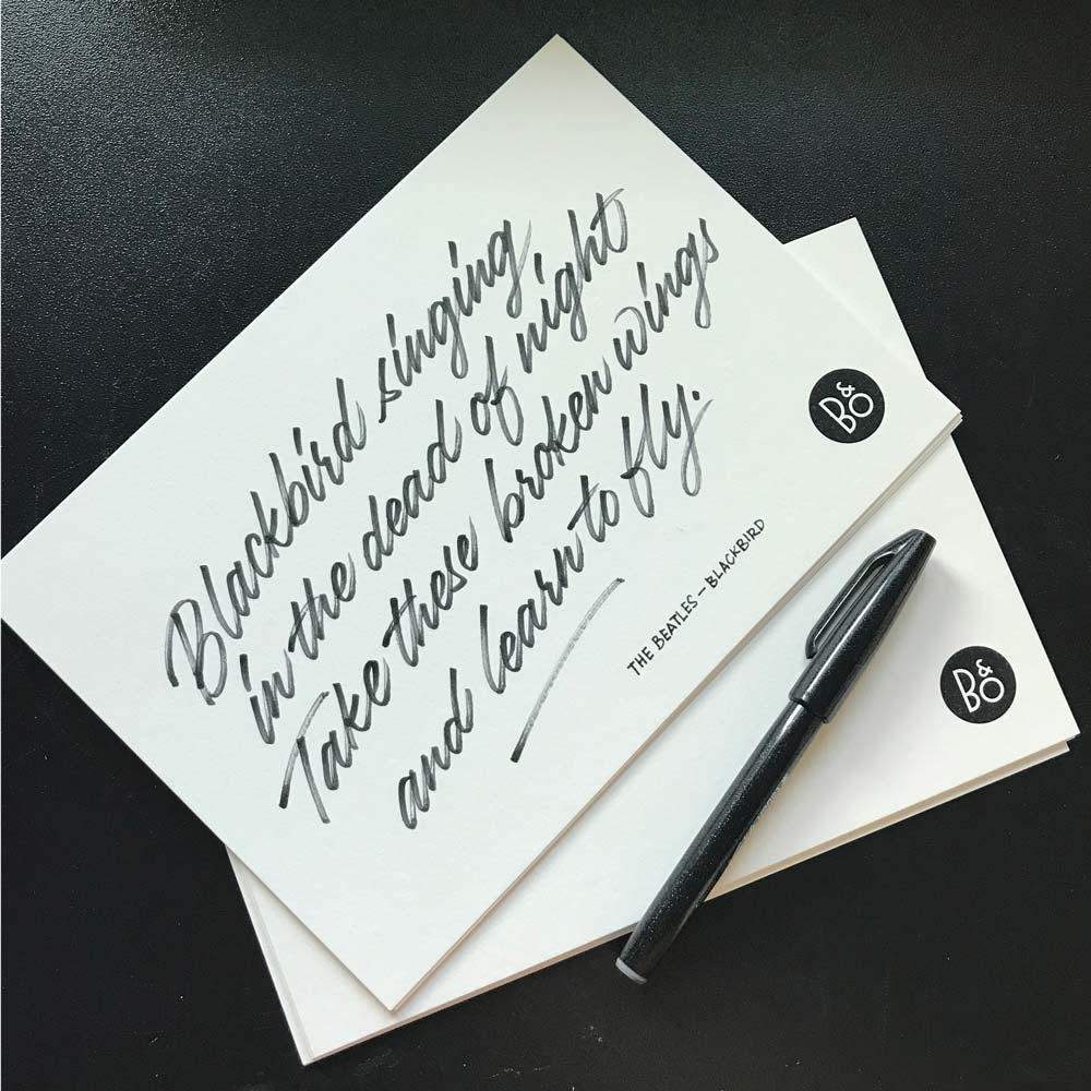 Hand written lyrics on card stock