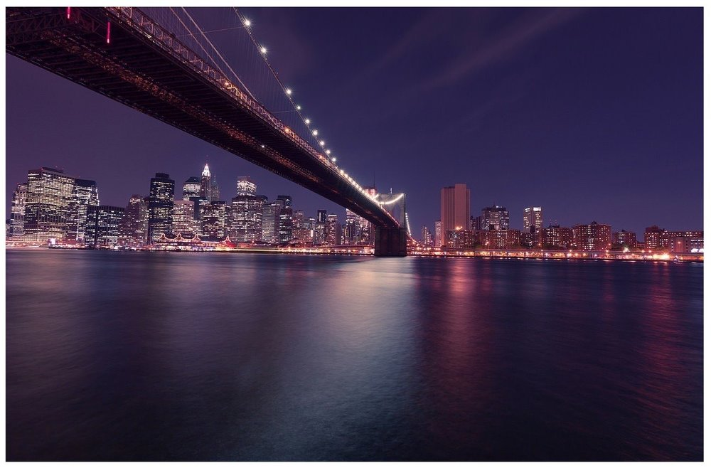 Brooklyn Bridge into New York City
