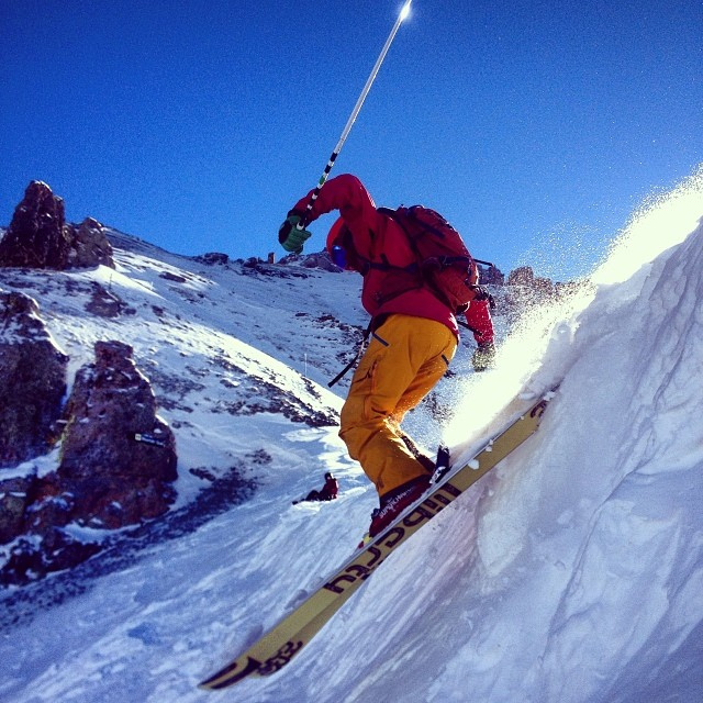 Sean a.k.a RedMan cornice dropping into Mountain Quail in Telluride's Black Iron Bowl