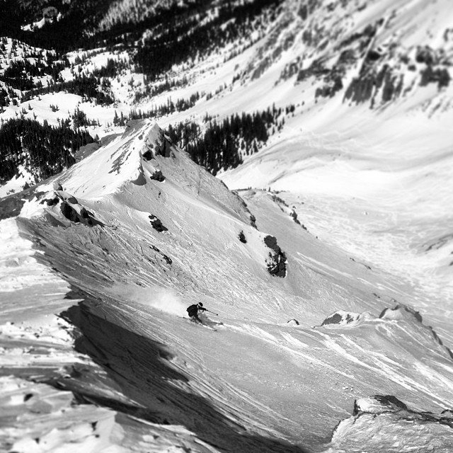 Slaying the powdery spring wind crust down Tramshot on Telluride's Palmyra Peak.