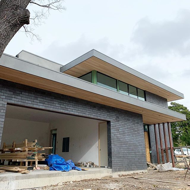 Cypress soffits, black brick and gray stucco...we are loving the color palette on our Kessler Woods project. #modernarchitecture #dallasmodern #dwell #archilovers #architecture #modern #blackbrick #graystucco #cypress