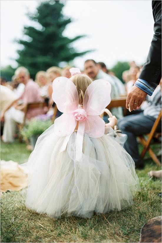 Instant cuteness for a flower girl: just add wings.