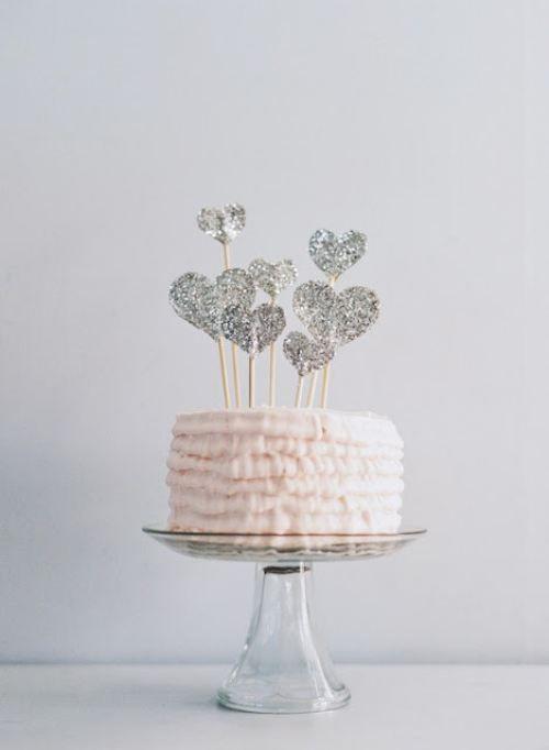 Glitter heart-topped cake