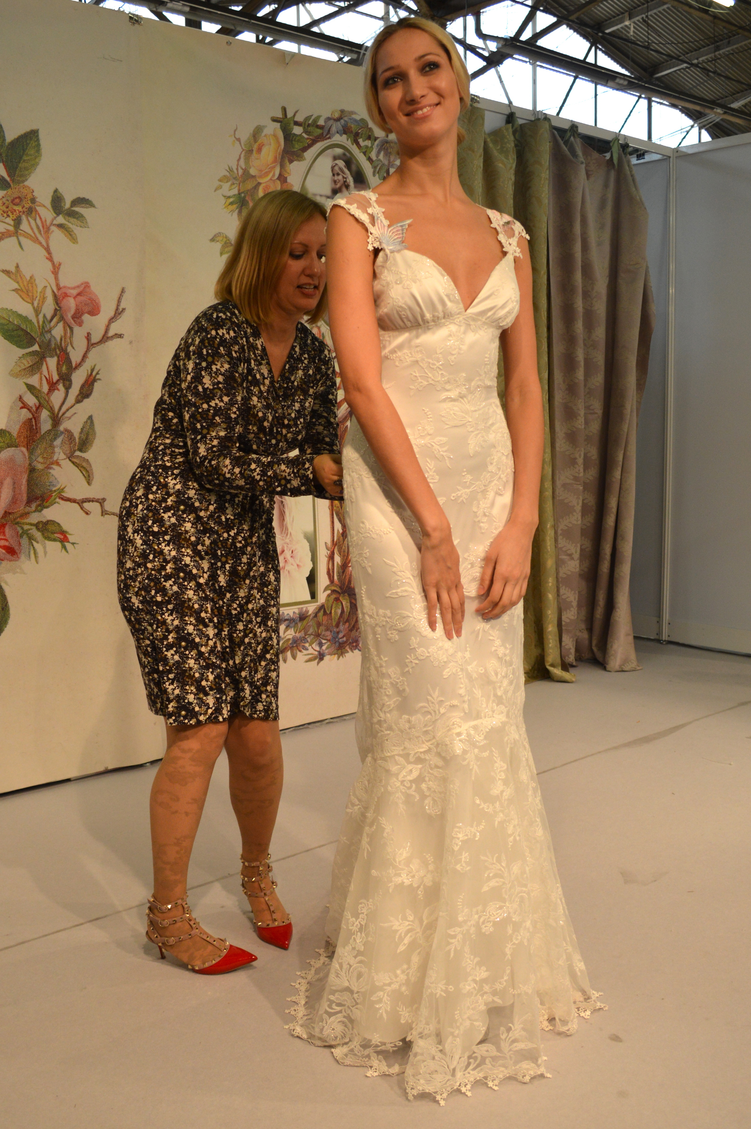 Claire Pettibone ensuring a perfect fit on the Papillon gown