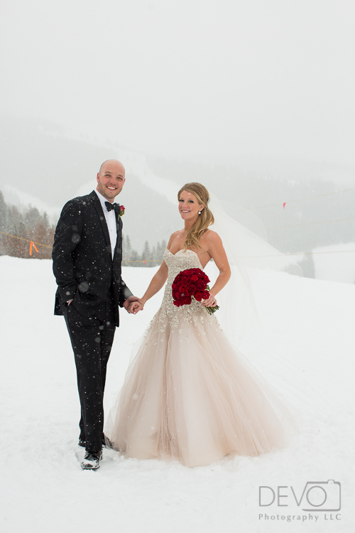 Little White Dress Bride Abby at her wedding in Vail, Colorado - wearing a Liancarlo gown