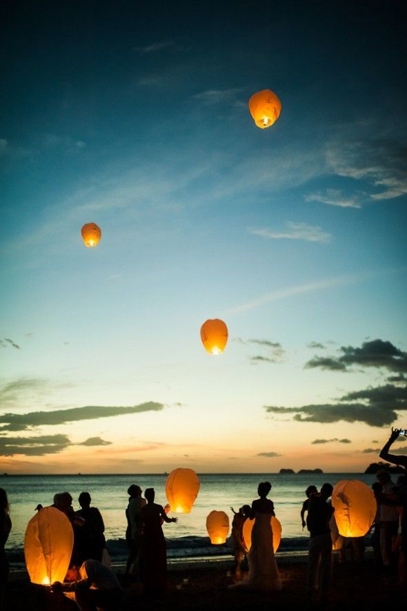 Boho beach wedding lantern release sunset