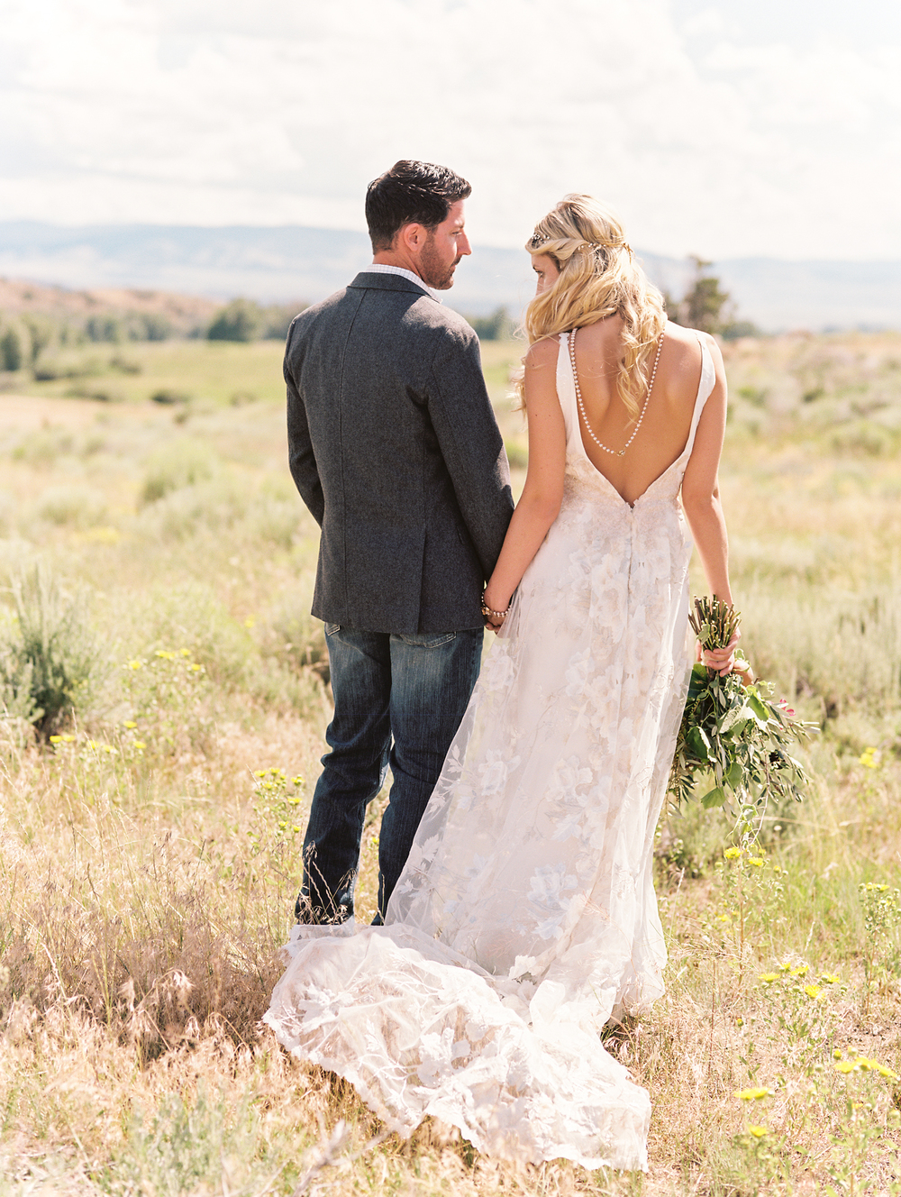 Bohemian Wedding Inspiration at Brush Creek Ranch | Claire Pettibone Raven gown from Little White Dress Bridal Shop | Photography: Lisa O'Dwyer