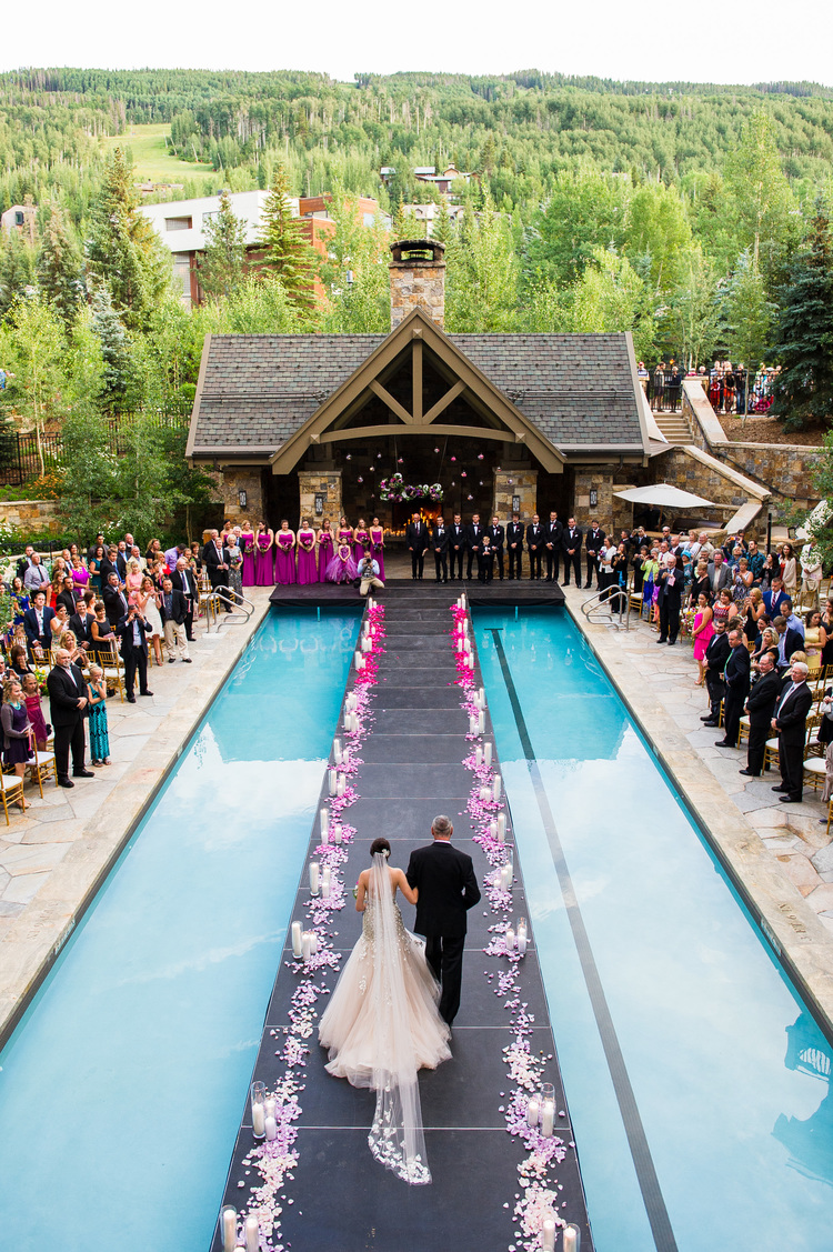 Its Going To Be A Good Wedding When You Learn That Jessica And Dereks Aisle Was Specially Built Platform Over The Pool Of Four Seasons In Vail