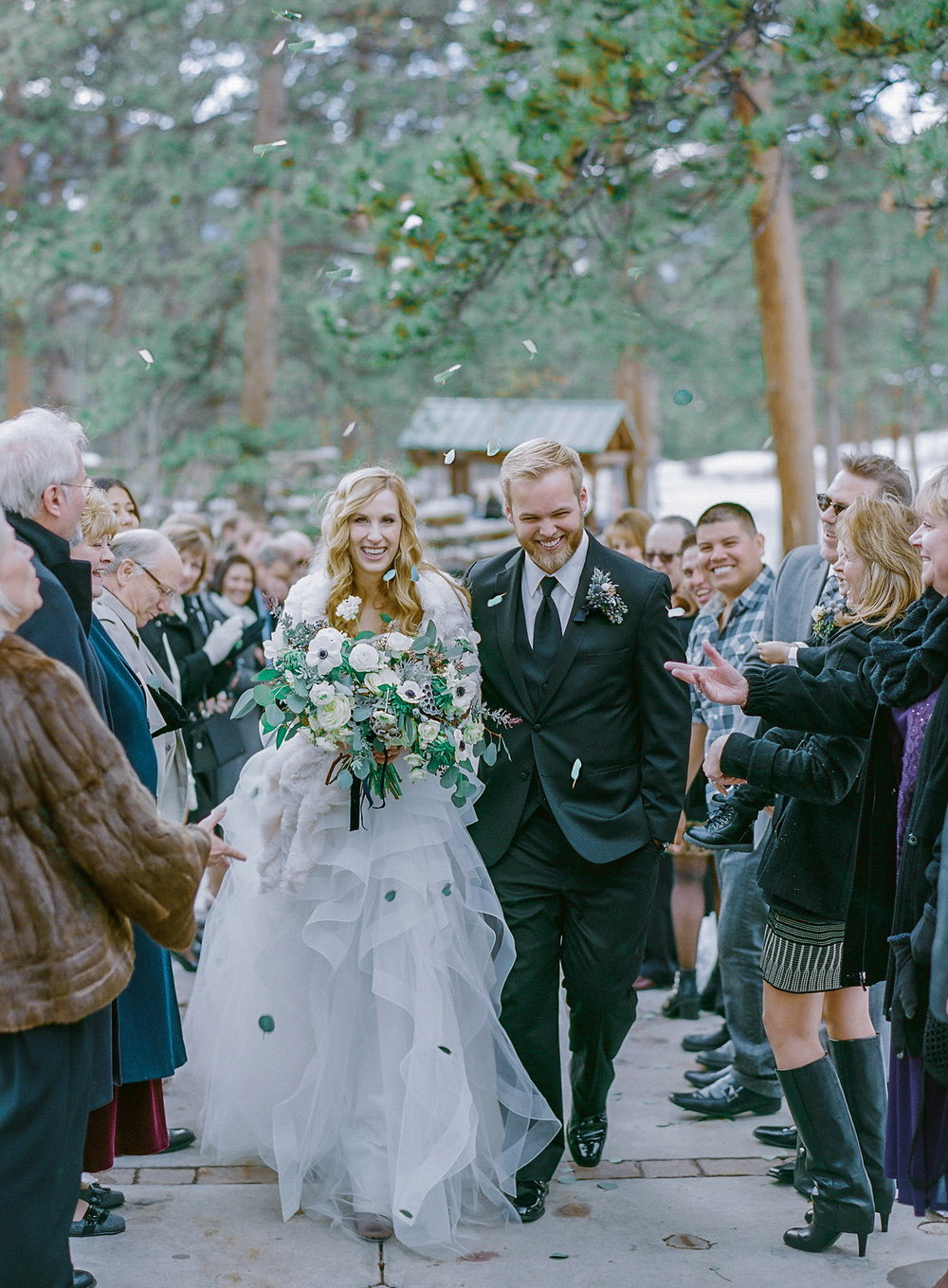 Winter Wedding in Estes Park, Colorado | Della Terra Mountain Chateau | Reem Acra Eliza Wedding Dress | Photography by Shannon Von Eschen