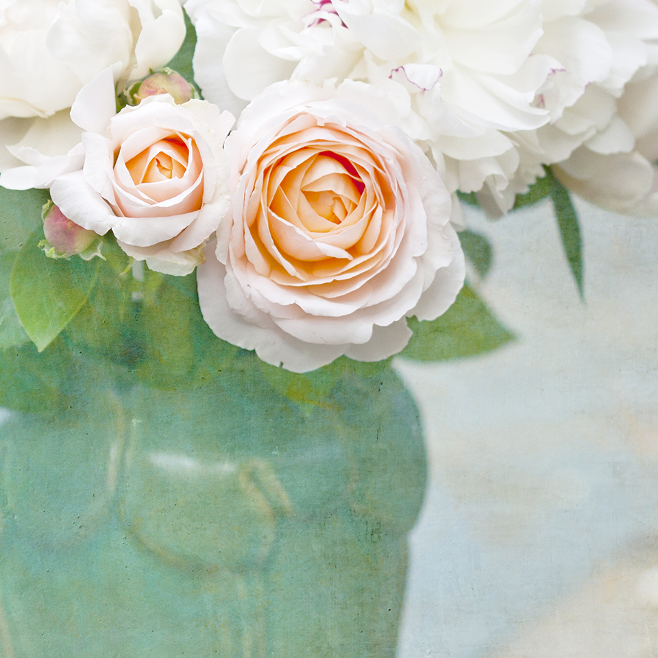 Green vase of roses and peonies