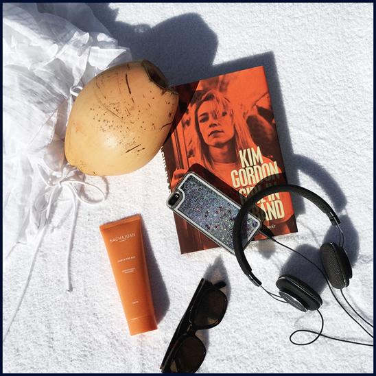 Pool side essentials:  Loup Charmant  cover-up, Sachajuan  Hair In The Sun,  Céline sunglasses,  Girl in a Band: A Memoir  by Kim Gordon,  Bowers & Wilkins  headphones
