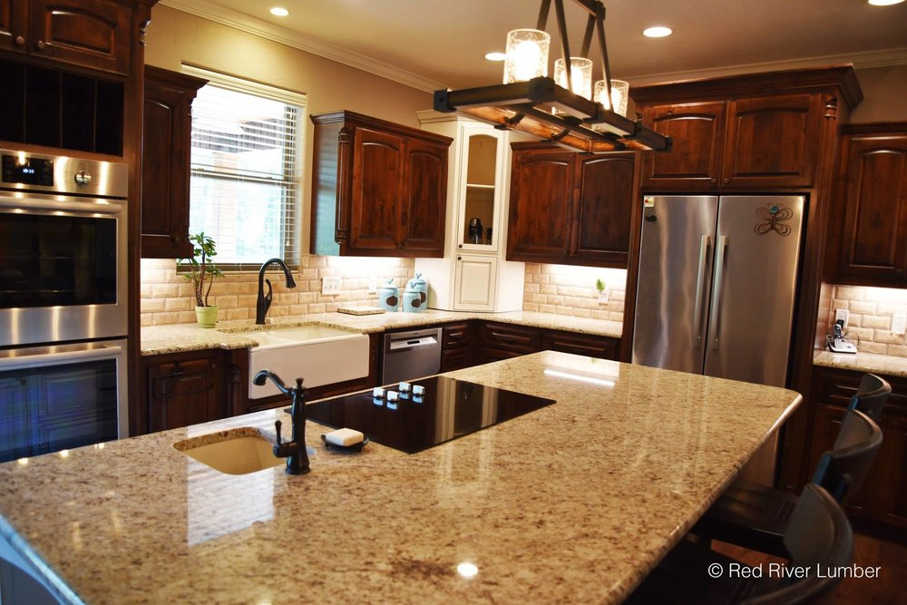 We supplied cabinet materials,  Bosch Home  Appliances, fabricated/installed the Giudoni Ornamental Granite Countertops, and supplied the luxury vinyl plank flooring.