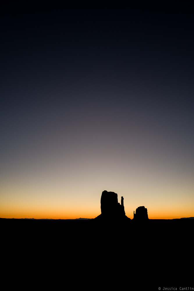 Sunrise over the mittens in Monument Valley.