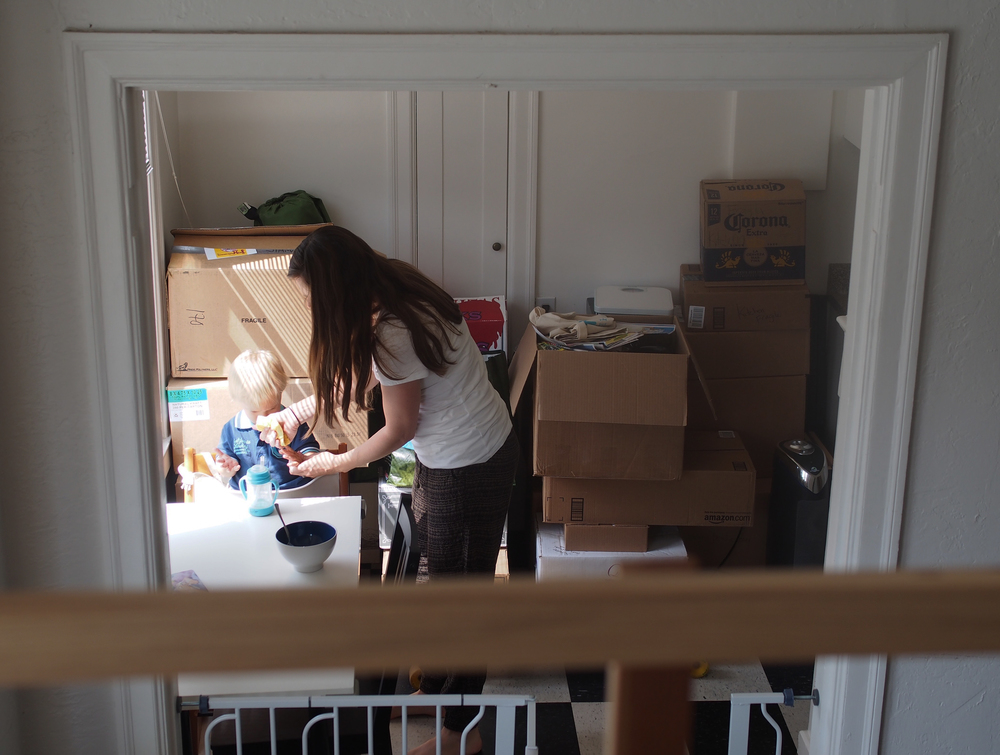 Packing boxes signal the end of the Kroleski's memorable time as a family in their 400 sq ft studio apartment.