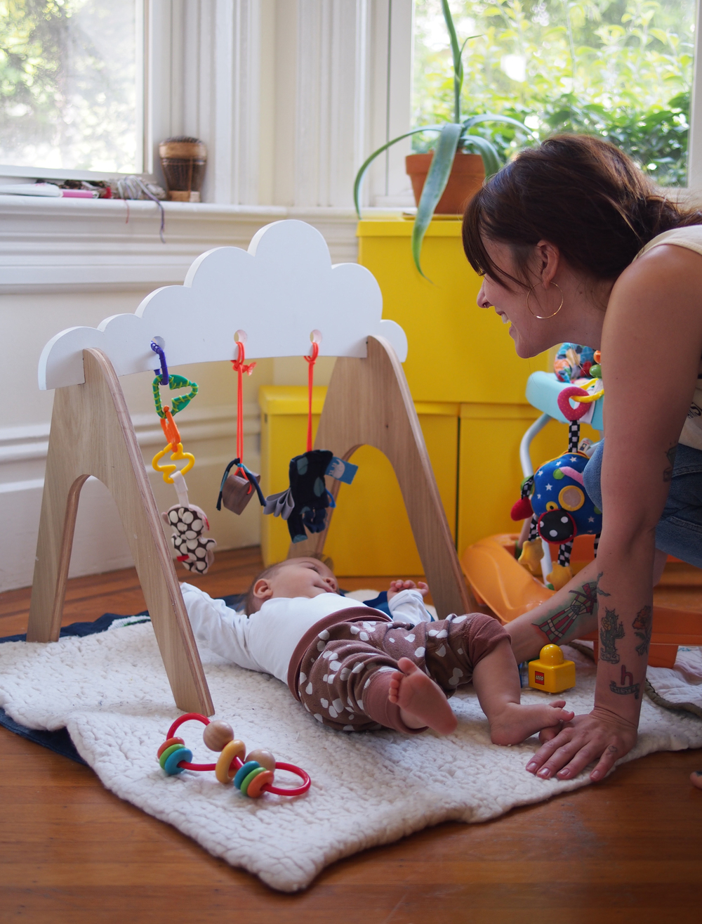 Alma plays in the clouds thanks to her handmade baby gym.