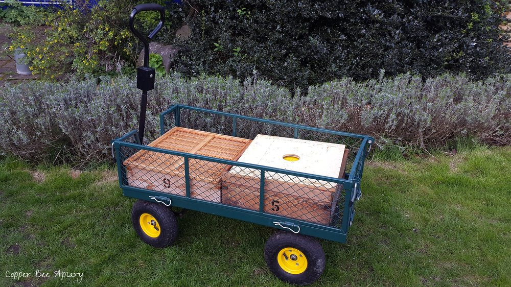 The handy garden trolley has been super useful for transporting hive parts between car and bee shed at home. It perfectly fits two supers side by side.