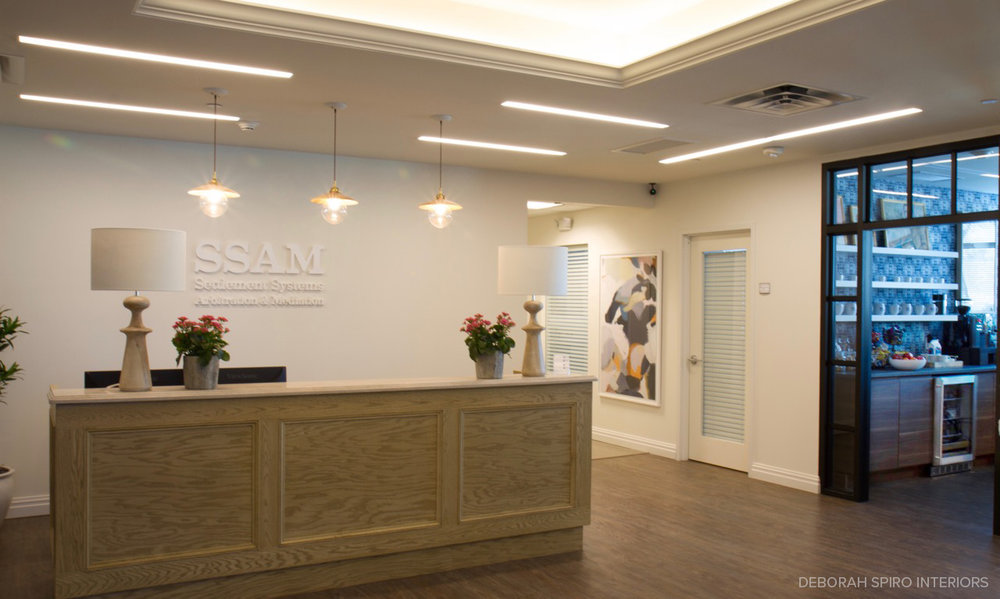 SSAM reception desk with view of coffee bar.jpg