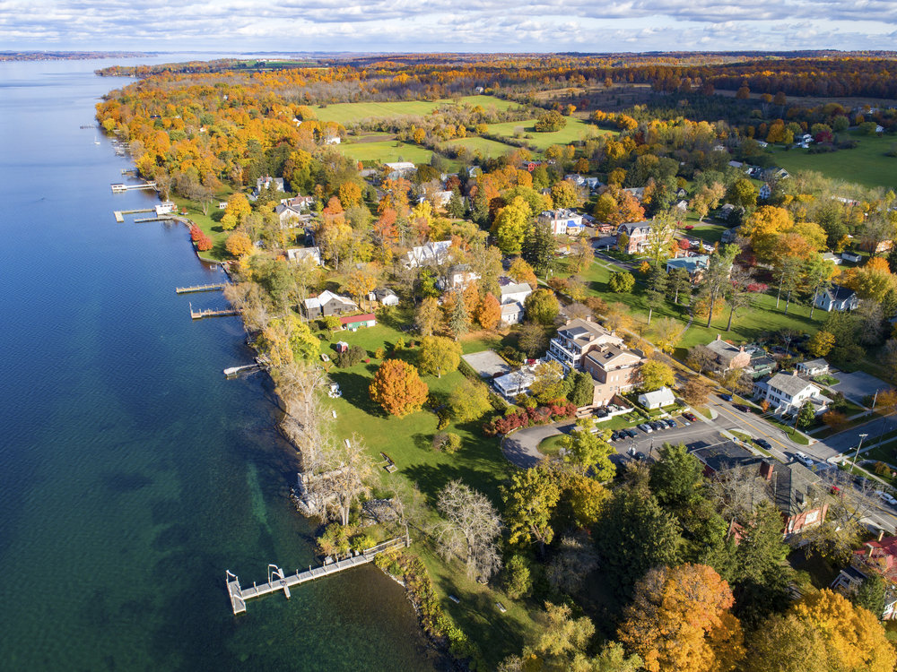 Aerial view of the picturesque, historic lakeside Village of Aurora, New York on the east side of Cayuga Lake.