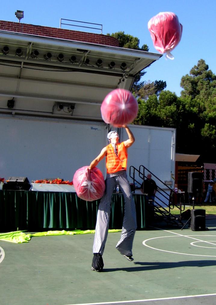 Rob Crites Juggling 3 bean bag chairs on Stilts.jpg