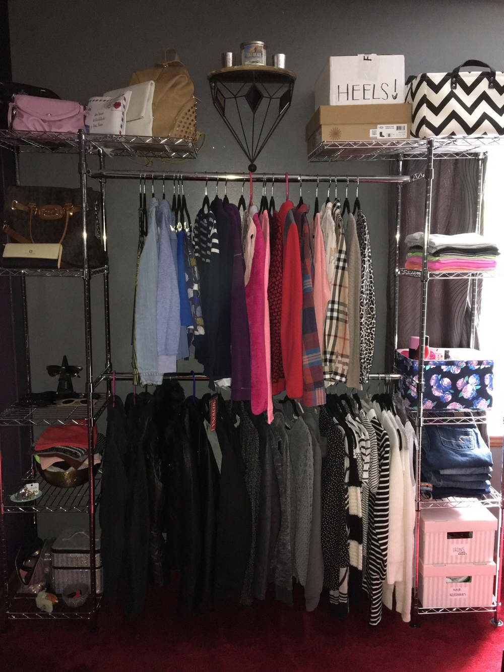 I bought this clothes rack at the end of last year because it was starting to get harder and harder for me to fit all of my clothes into my tiny closet and even though I currently have two dressers, each drawer is occupied with other types of clothing. I also can not stand my clothes being wrinkly so this is a great way to not only give character to my room, but to also keep my clothes sorted out and wrinkle-free.