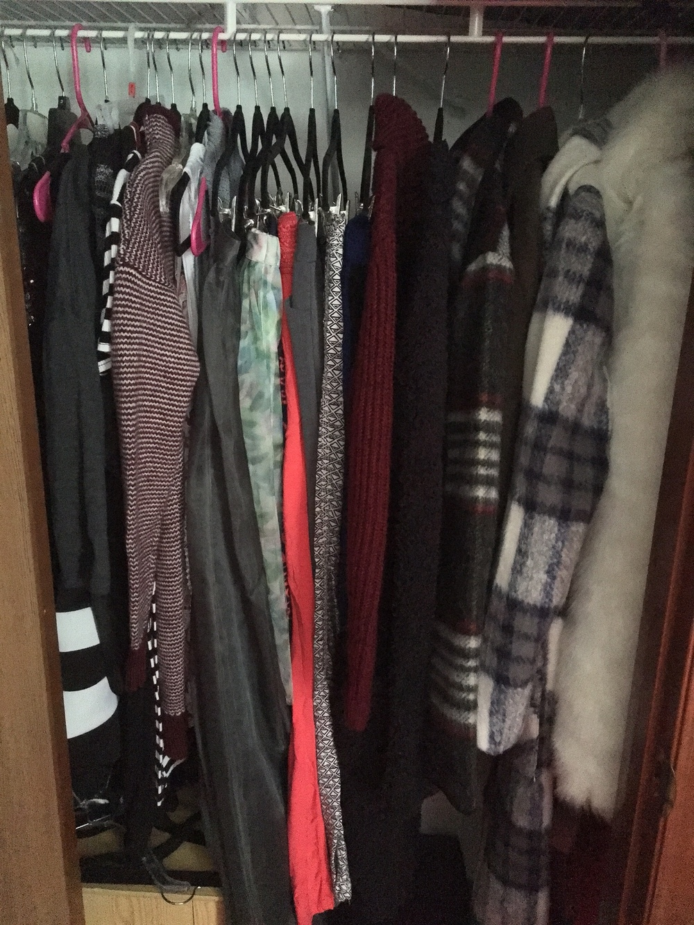 This is the inside of my closet, which is actually located on my wall that I recently painted. I tried to color-code it just like everything, but I started with my dresses, skirts/trousers, long shirts, then coats.- I don't think my closet has ever looked neater than it does now! I love it!