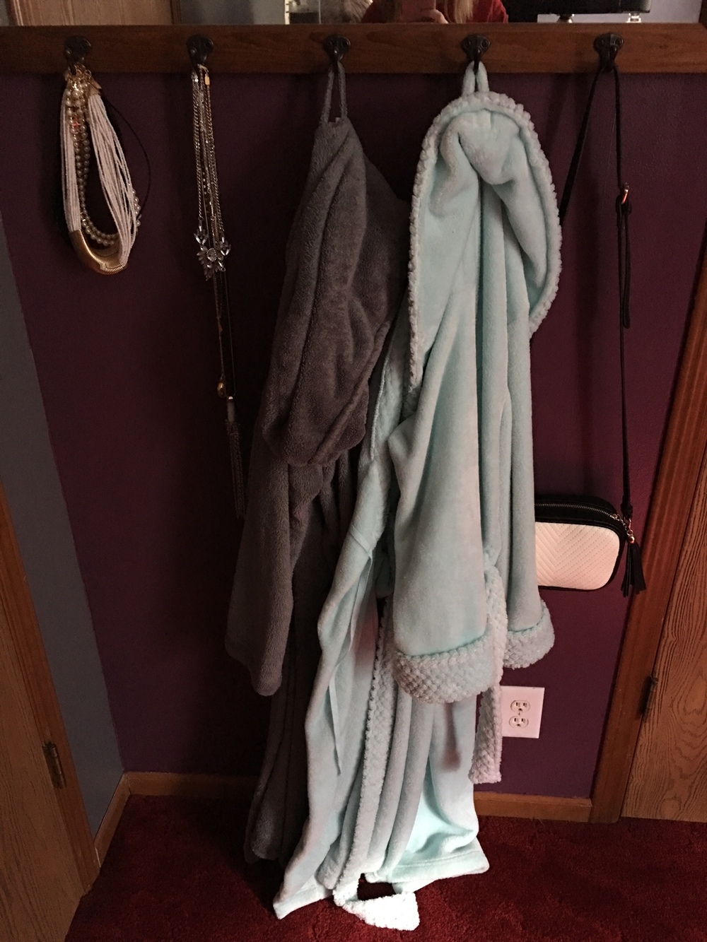 This is a picture of what's hanging on my newly-painted wall behind my bedroom door. I'm not sure what the proper name is for this mirror/hanger thing, but as you can see it's holding my necklaces, bathrobes, and my current every-day bag.