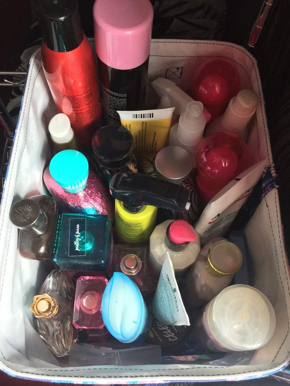 I keep all of my hair products,lotions, perfumes, and deodorant in a cute floral basket. I used to have them all out and standing on the shelf, but I thought it looked a little messy so putting them all into this little basket helped keep everything together and looking nice.