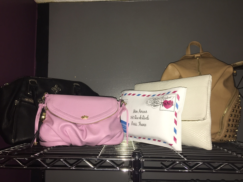 Recently I have gone through all of my makeup bags, purses, clutches, backpacks, and wallets and the ones I decided to keep I put on the top left side of my clothes rack. I stuffed all the bags you see here, with my makeup bags and wallets to make them stand up so it's easier for me to see, when I'm trying to choose the perfect bag to match my outfit.