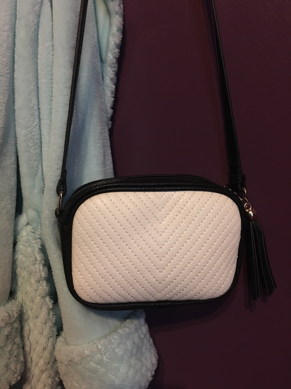 Currently, I have downsized my every-day handbag to my black and white Francesca's crossbody bag. It's so cute and it's just big enough to hold only the necessities, which is all I've needed lately whenever I've gone out. I feel like everyone needs a small crossbody bag like this in their handbag stash because it just goes great with every outfit and I don't know about you, but I don't enjoy lugging around a huge handbag everywhere I go! It's nice to have just a small one to hold the necessities and not weigh you down the entire time! I really do like crossbody bags a lot because it's light, always with you, and out of the way.
