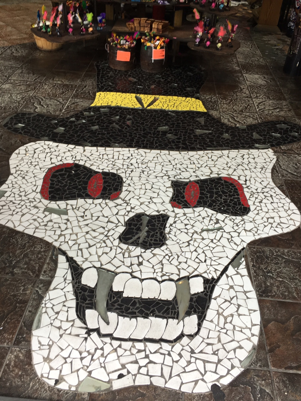 This is what the floor looked like right when you walked into one of the Voodoo stores on the businessy-side of New Orleans. Also, the Voodoo dolls you see above the skull were pretty much what all the Voodoo dolls looked like.