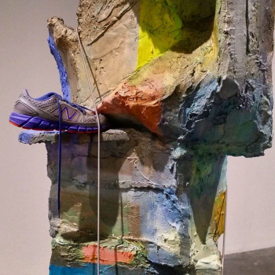 Detail of artist Rachel Harrison's   XLT Footbed   (2013) wood, plystyrene, cardboard, cement, acrylic paint, shoe, metal stanchions (Tate Modern, London)