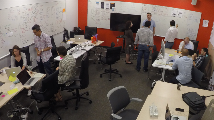 LEFT: Design building a prototype for testing | CENTER: UX, Dev, QA discussing login | RIGHT: UX, BA, SM writing stories