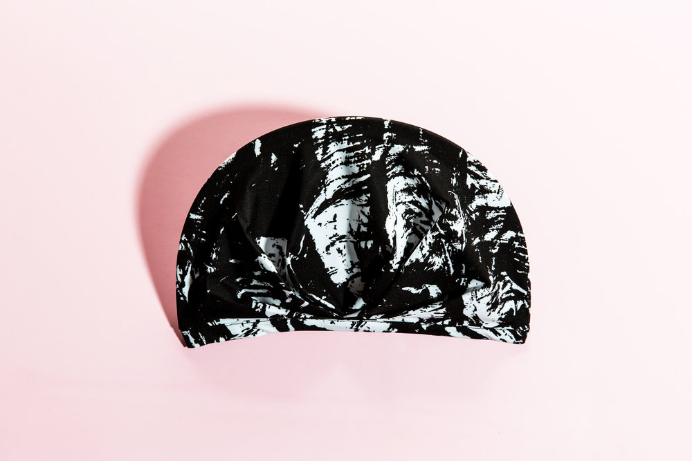 The SHHHOWERCAP Shower Cap lasts longer than plastic shower caps. SHHHOWERCAP is antibacterial to prevent mold, it is made in the USA, and it is machine-washable. Image features The Kent Black and White Print SHHHOWERCAP Shower Cap. All Rights Reserved, SHHHOWERCAP.