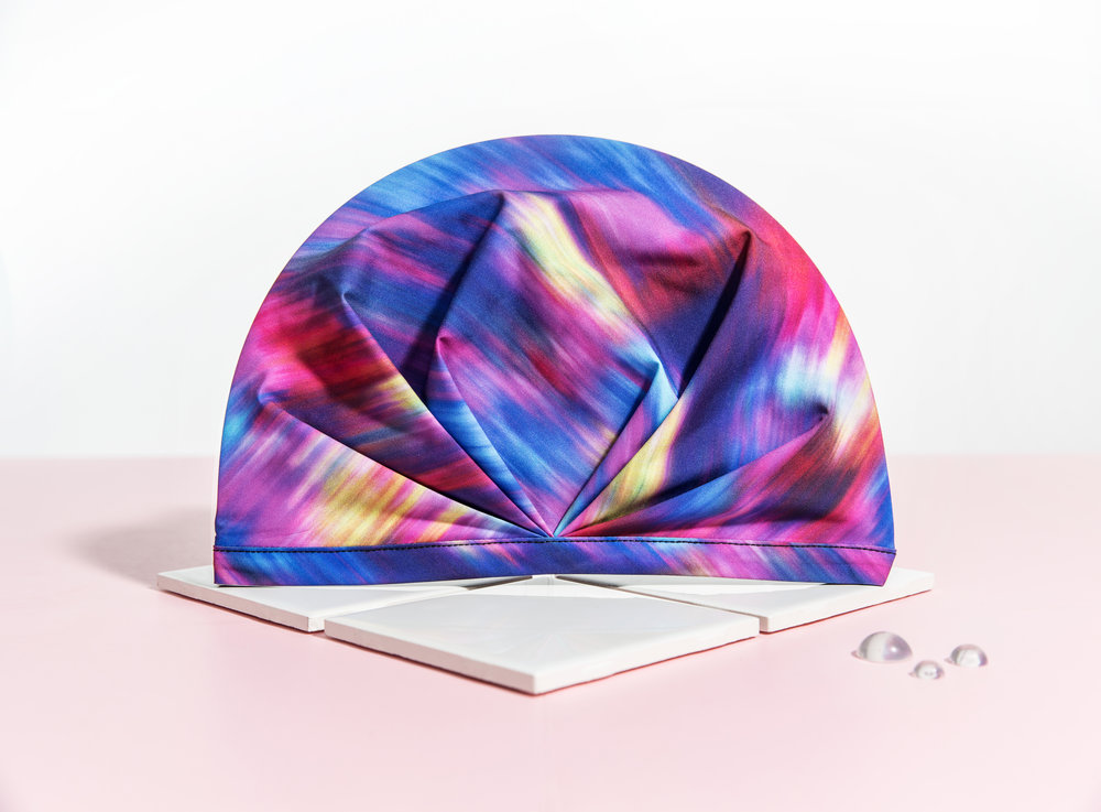SHHHOWERCAP shower cap is quick-drying so it is good for travel or the gym. Image of The Laguna Rainbow Watercolor SHHHOWERCAP. All Rights Reserved, SHHHOWERCAP.